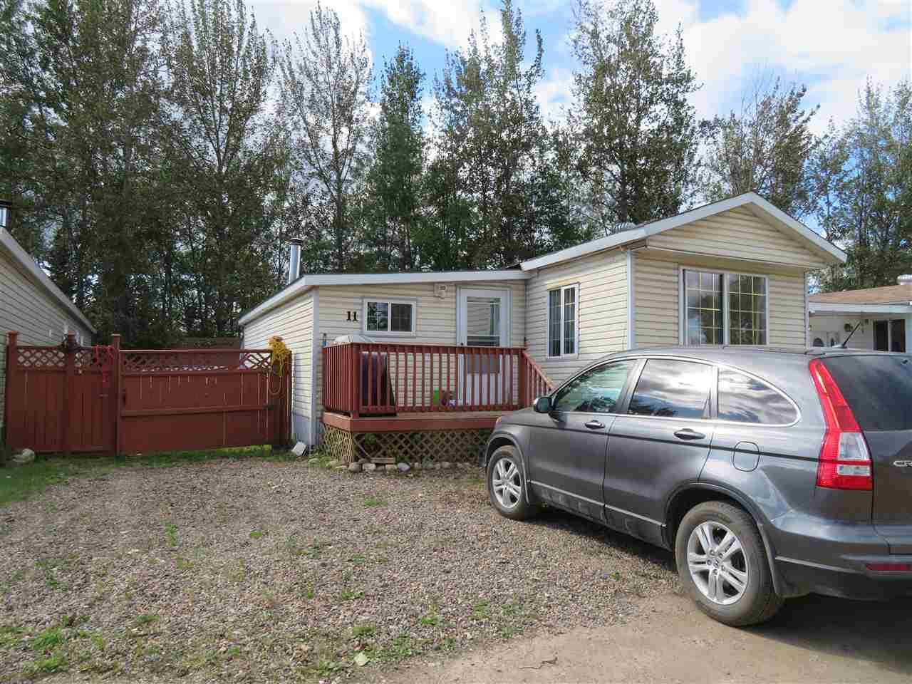 "Main Photo: 11 2963 KLAHANNIE Drive in Fort Nelson: Fort Nelson -Town Manufactured Home for sale in ""KLAHANNIE TRAILER PARK"" (Fort Nelson (Zone 64))  : MLS®# R2485074"