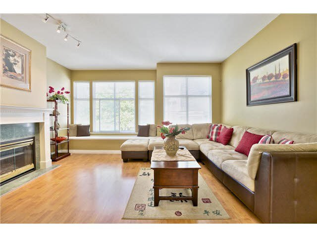 """Beautiful elegant and generous living room with updated floors and paint. Large windows allow lots of natural light facing the playground"