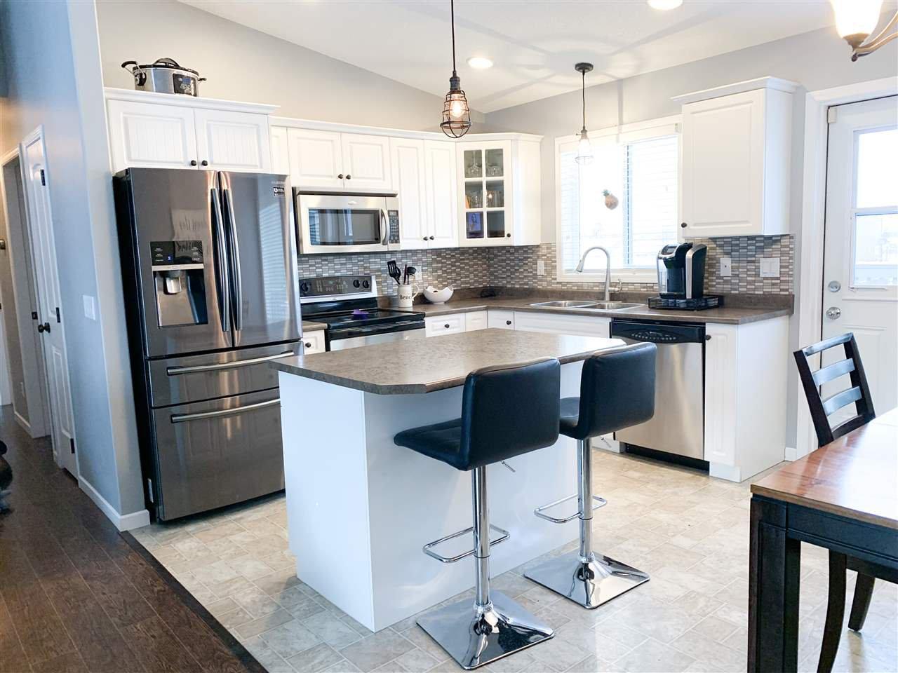 "Photo 2: Photos: 8724 114 Avenue in Fort St. John: Fort St. John - City NE House for sale in ""PANORAMA RIDGE"" (Fort St. John (Zone 60))  : MLS®# R2428633"