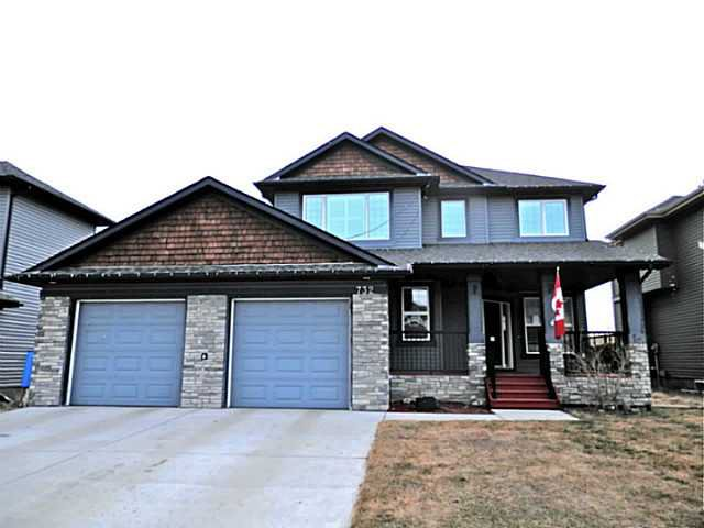 Stone exterior finishing and over sized garage doors.