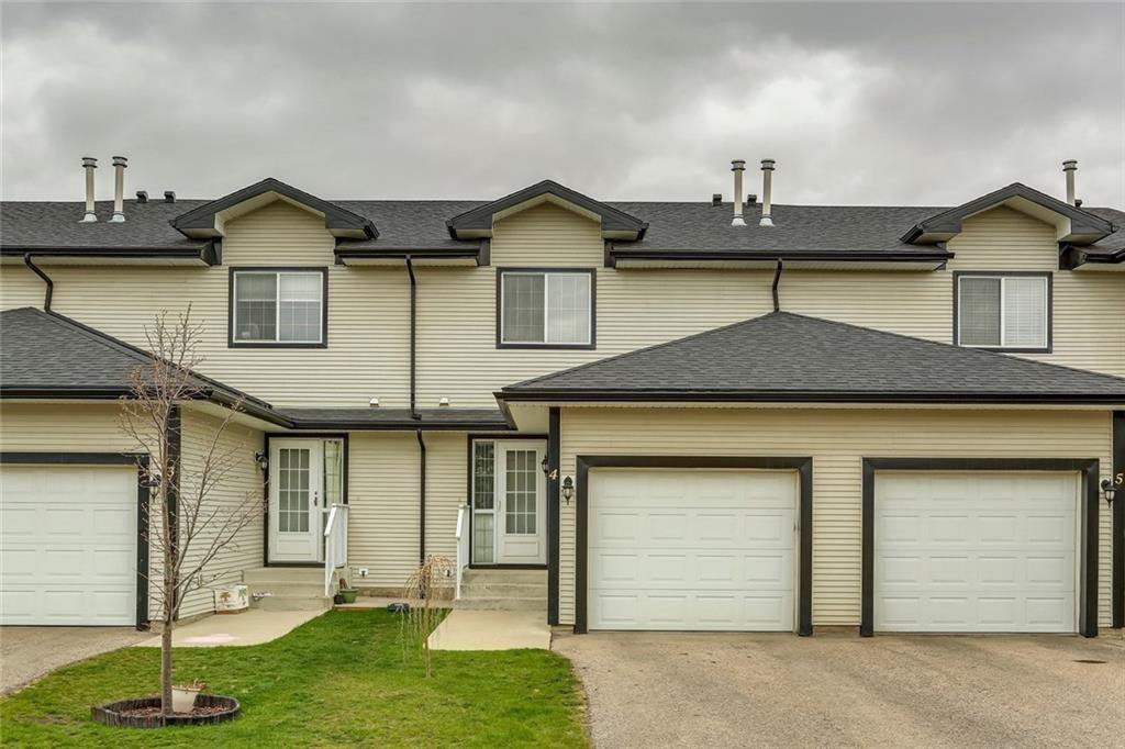 Main Photo: 4 12 SILVER CREEK Boulevard NW: Airdrie Row/Townhouse for sale : MLS®# A1029688