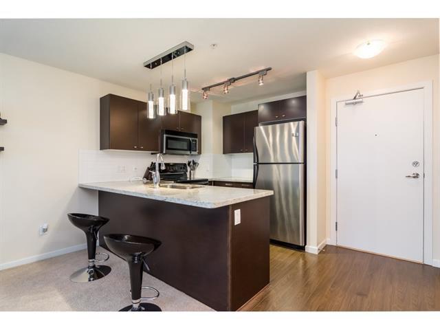 Photo 3: Photos: 207 18755 68 Avenue in Surrey: Clayton Condo for sale (Cloverdale)  : MLS®# r2302121