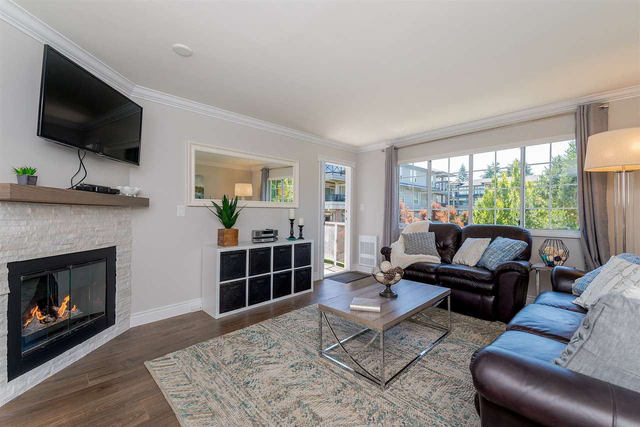 Main Photo: 305 15338 18 AVENUE in Surrey: King George Corridor Condo for sale (South Surrey White Rock)  : MLS®# R2288918