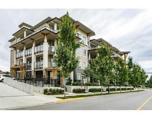 Main Photo: 211 12409 Harris Road: Condo for sale (Pitt Meadows)  : MLS®# R2083691