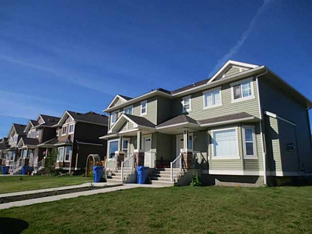 Main Photo: 322 Mcleod Crescent: Turner Valley Half Duplex for sale : MLS®# C3583898