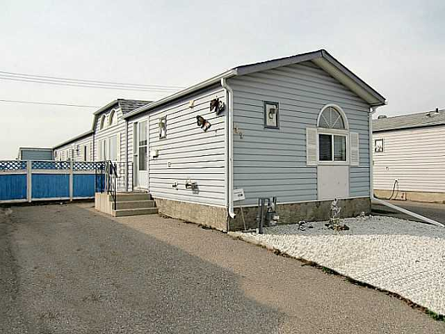 Nice Curb Appeal. Large 17 x 47 Foot Paved Driveway. Gated Fence Will Allow Storage of RV, Boat or your Toys.