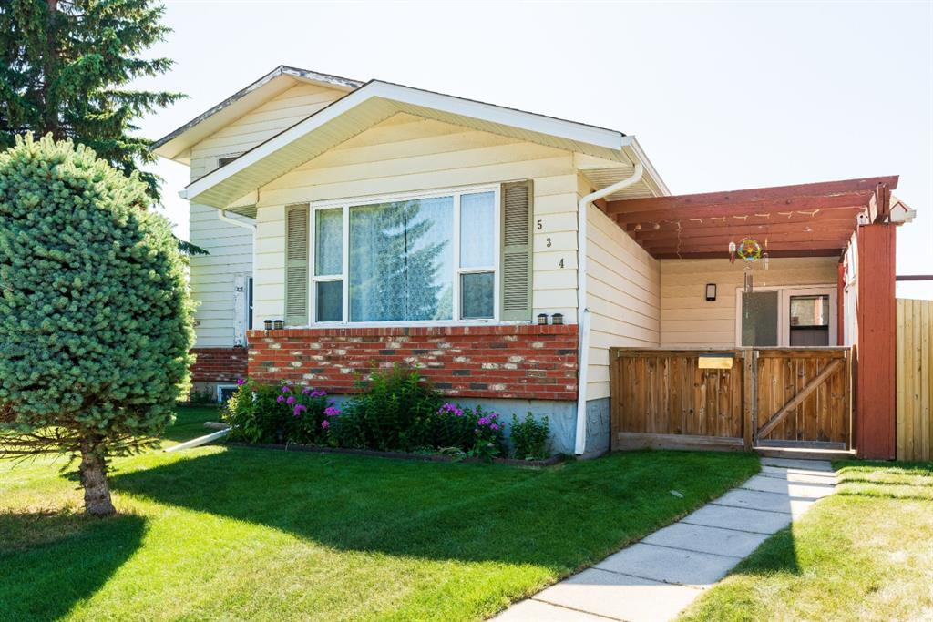 Photo 2: Photos: 534 QUEENSLAND Place SE in Calgary: Queensland Semi Detached for sale : MLS®# A1020359