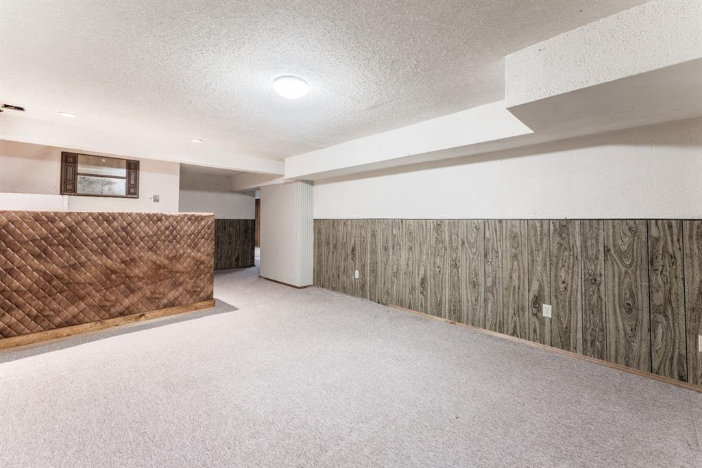 Photo 26: Photos: 534 QUEENSLAND Place SE in Calgary: Queensland Semi Detached for sale : MLS®# A1020359