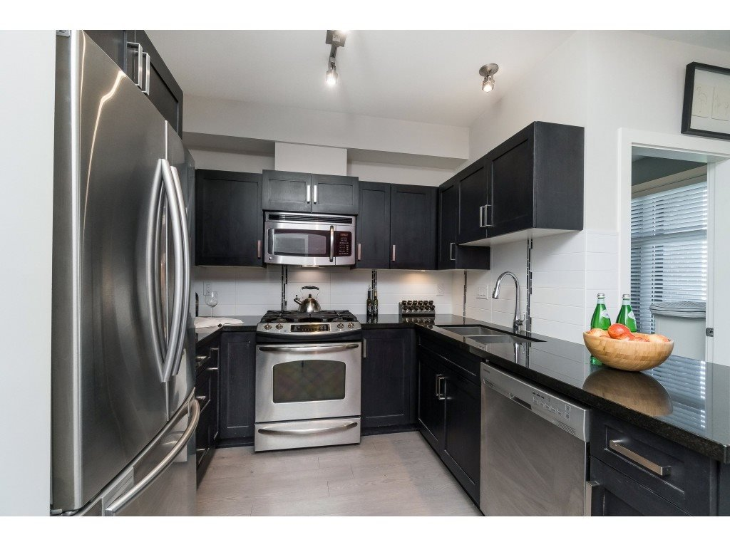 """Main Photo: 110 20058 FRASER Highway in Langley: Langley City Condo for sale in """"VARSITY"""" : MLS®# R2395381"""