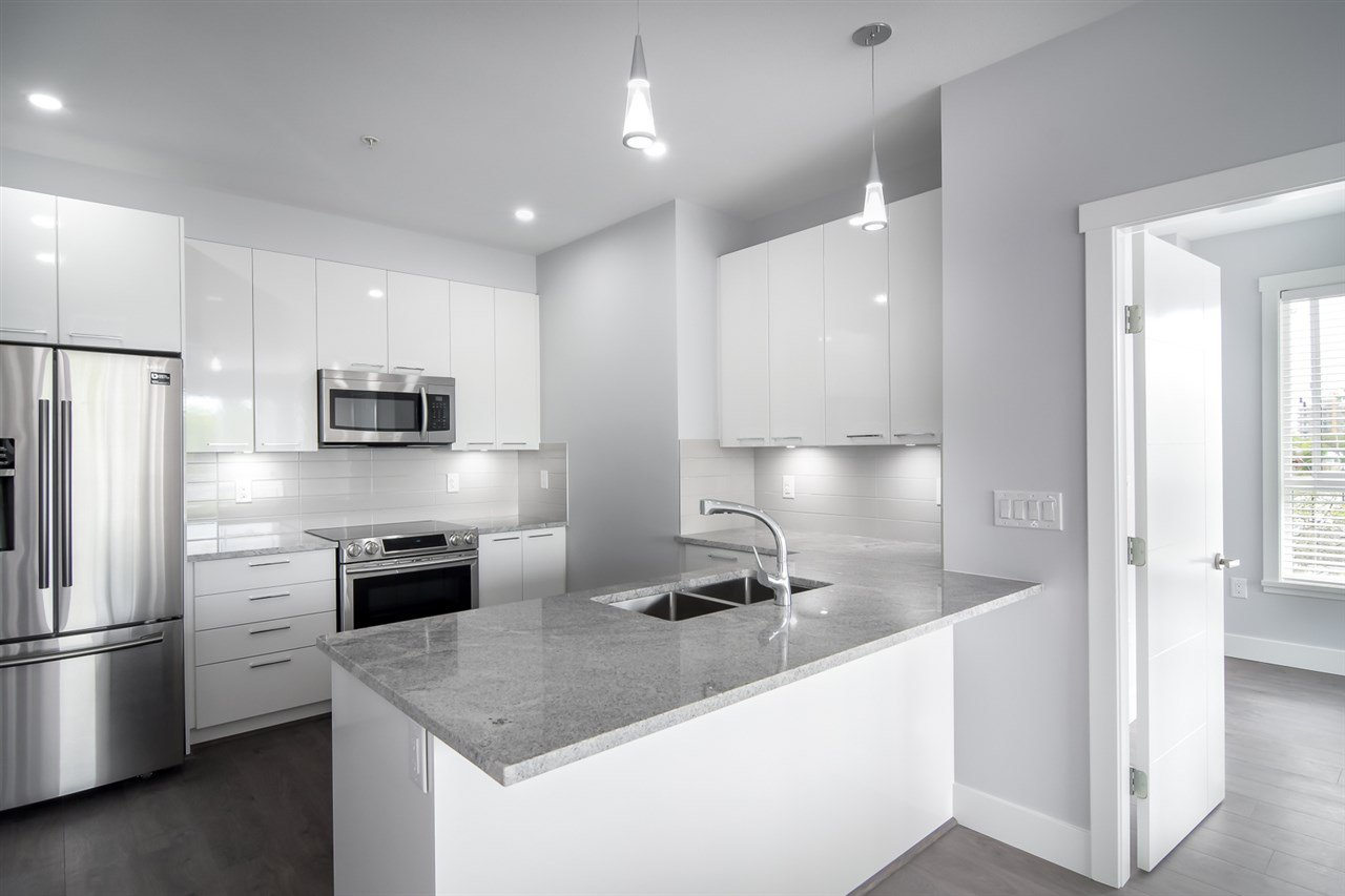 "Main Photo: 401 22315 122 Avenue in Maple Ridge: West Central Condo for sale in ""The Emerson"" : MLS®# R2397969"