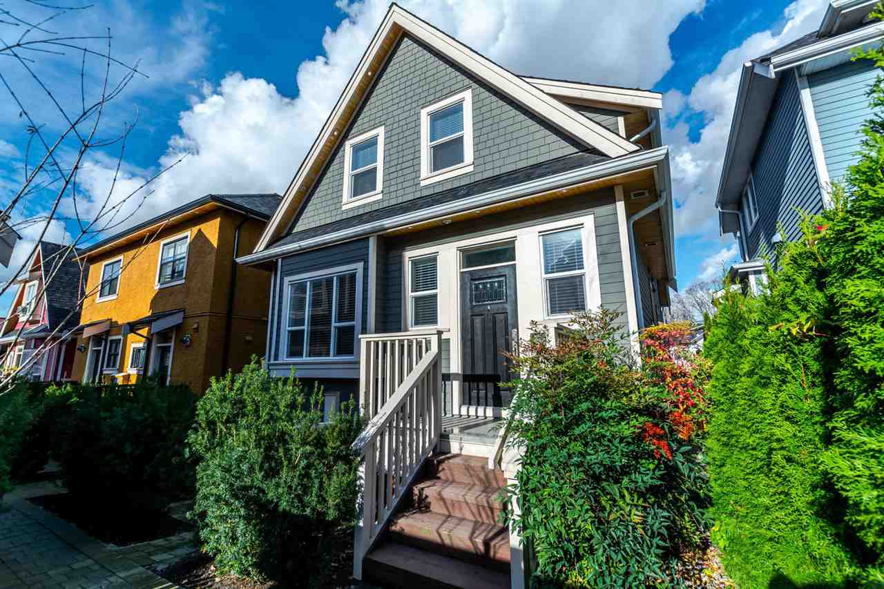 Main Photo: 1180 E KING EDWARD AVENUE in Vancouver: Knight House 1/2 Duplex for sale (Vancouver East)  : MLS®# R2122931