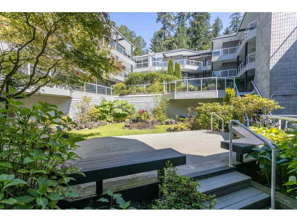 "Main Photo: 102 2733 ATLIN Place in Coquitlam: Coquitlam East Condo for sale in ""ATLIN COURT"" : MLS®# R2475795"