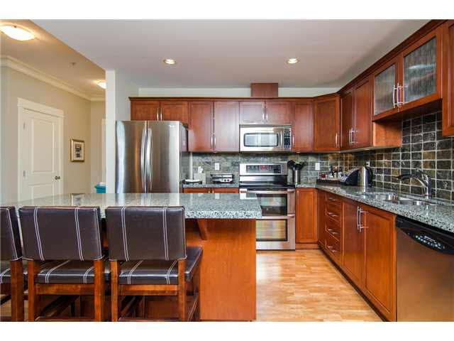 """Chef's kitchen with full-sized 2 yr LG fridge and stove"