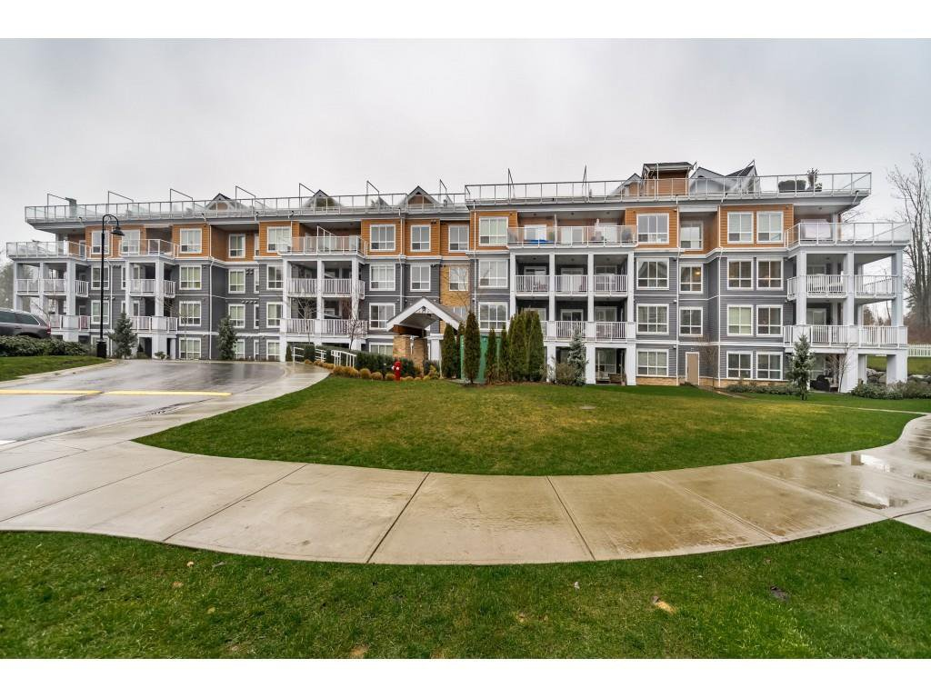 "Main Photo: 204 6470 194 Street in Surrey: Clayton Condo for sale in ""WATERSTONE-ESPLANADE"" (Cloverdale)  : MLS®# R2427138"