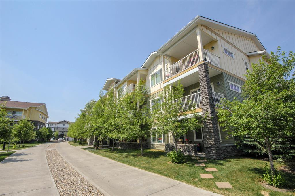 Main Photo: 2101 4 KINGSLAND Close SE: Airdrie Apartment for sale : MLS®# A1035883