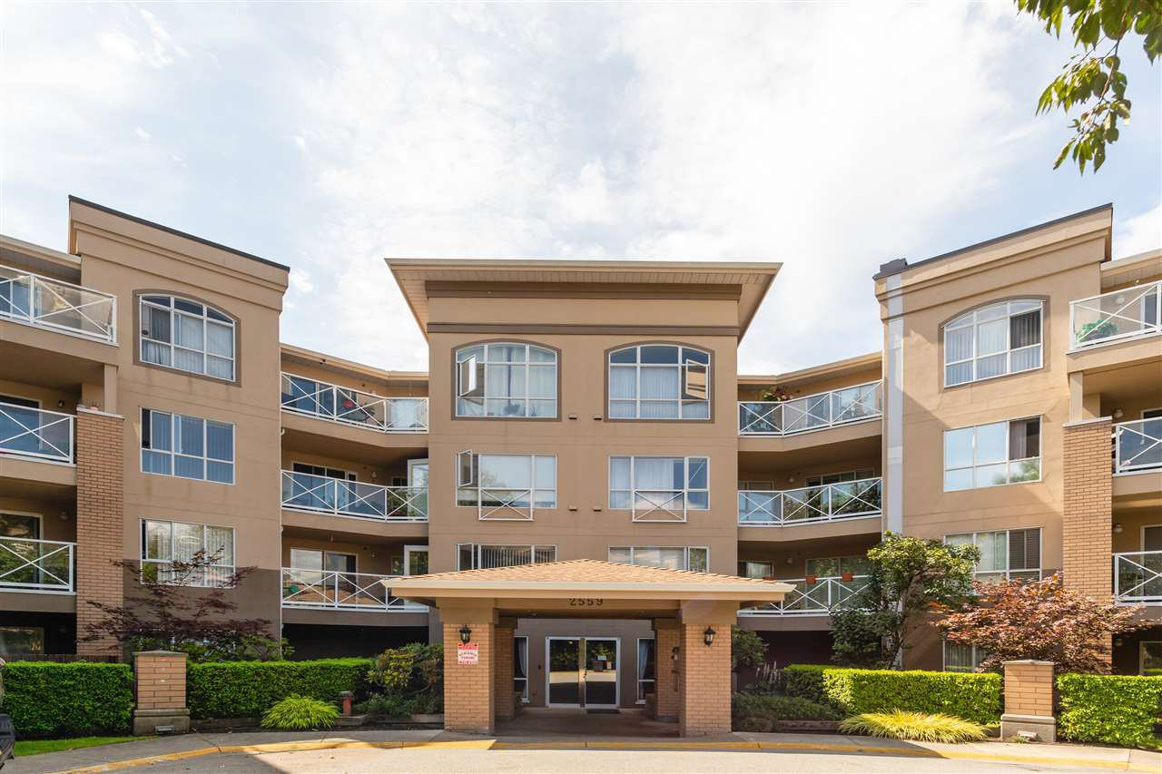 "Main Photo: 111 2559 PARKVIEW Lane in Port Coquitlam: Central Pt Coquitlam Condo for sale in ""THE CRESCENT"" : MLS®# R2486202"