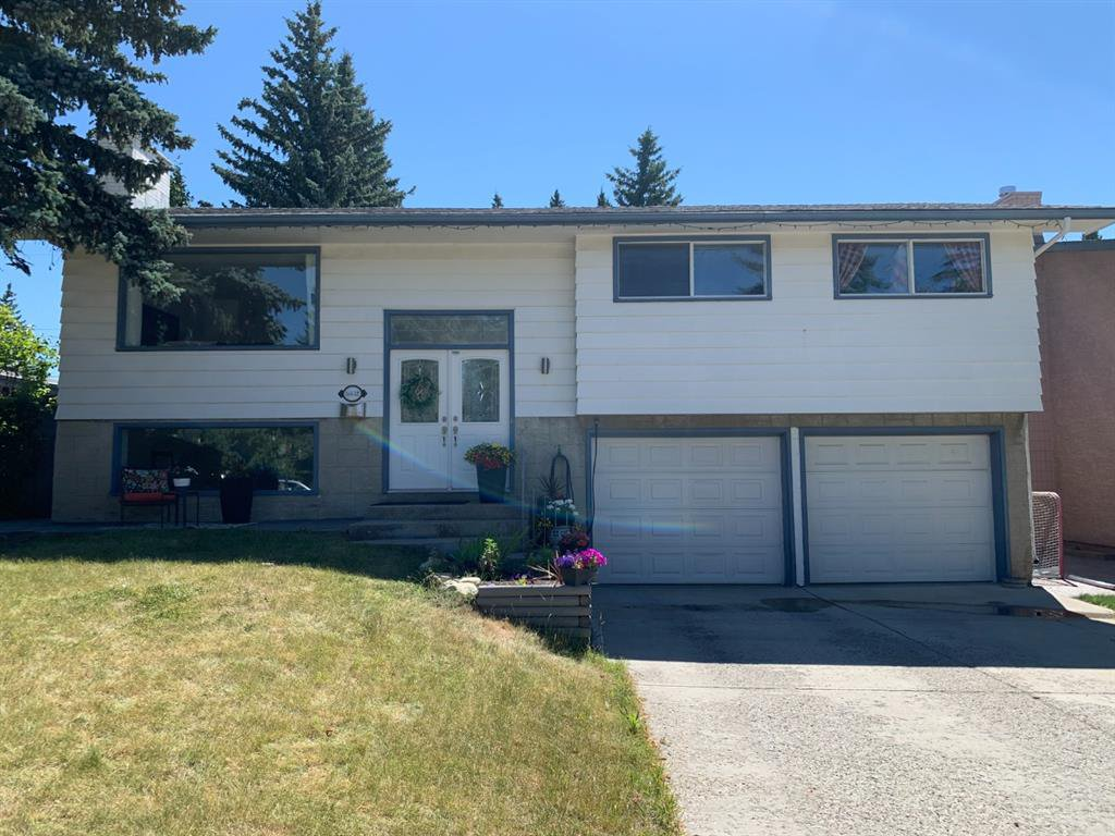 Main Photo: 5832 Lodge Crescent SW in Calgary: Lakeview Detached for sale : MLS®# A1046811