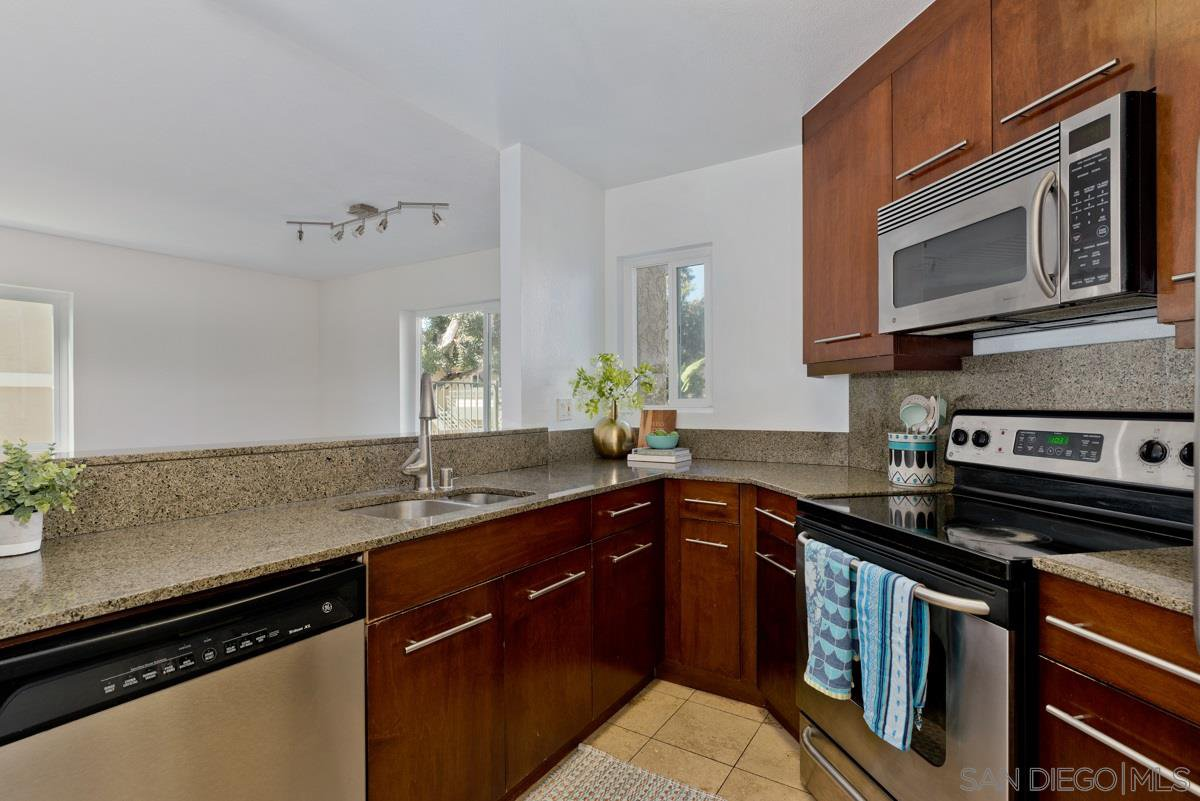 Main Photo: SAN DIEGO Condo for sale : 1 bedrooms : 7425 Charmant Dr #2603