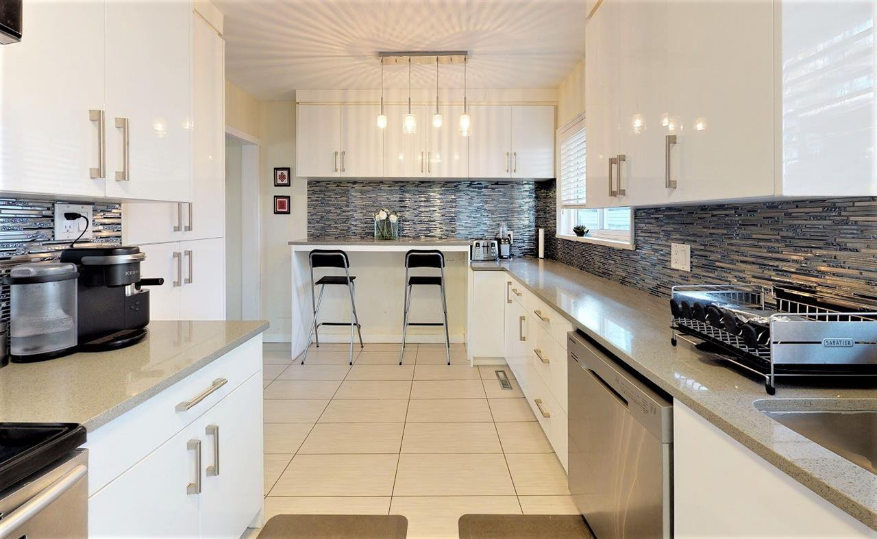 """Main Photo: 7863 119A Street in Delta: Scottsdale House for sale in """"RD3 DUPLEX_SINGLE DETACHED RES"""" (N. Delta)  : MLS®# R2421141"""
