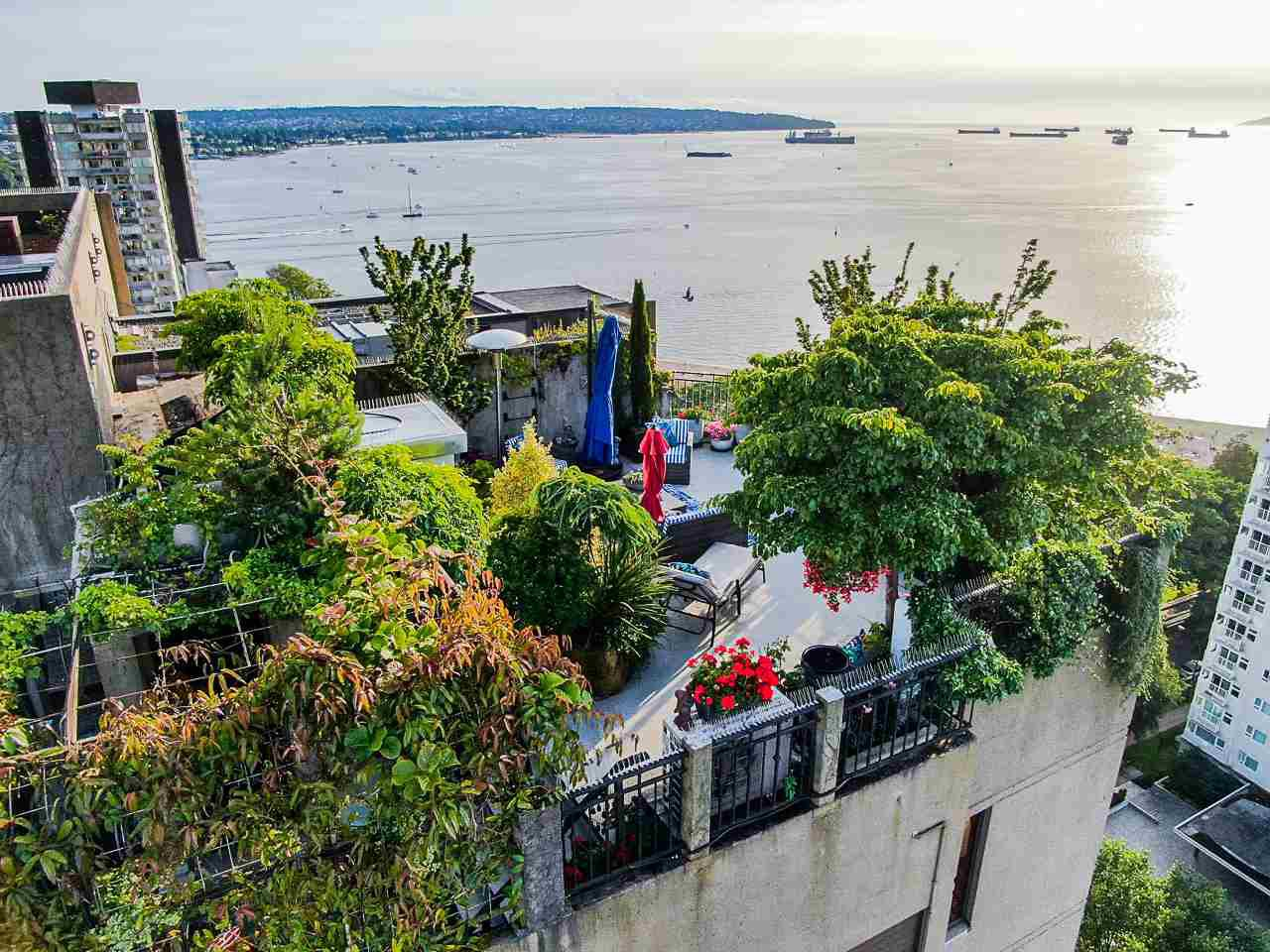 Mature trees and attractive hard scape make this a welcome retreat anytime of the day.  The view is classic English Bay, the gateway to the Pacific.