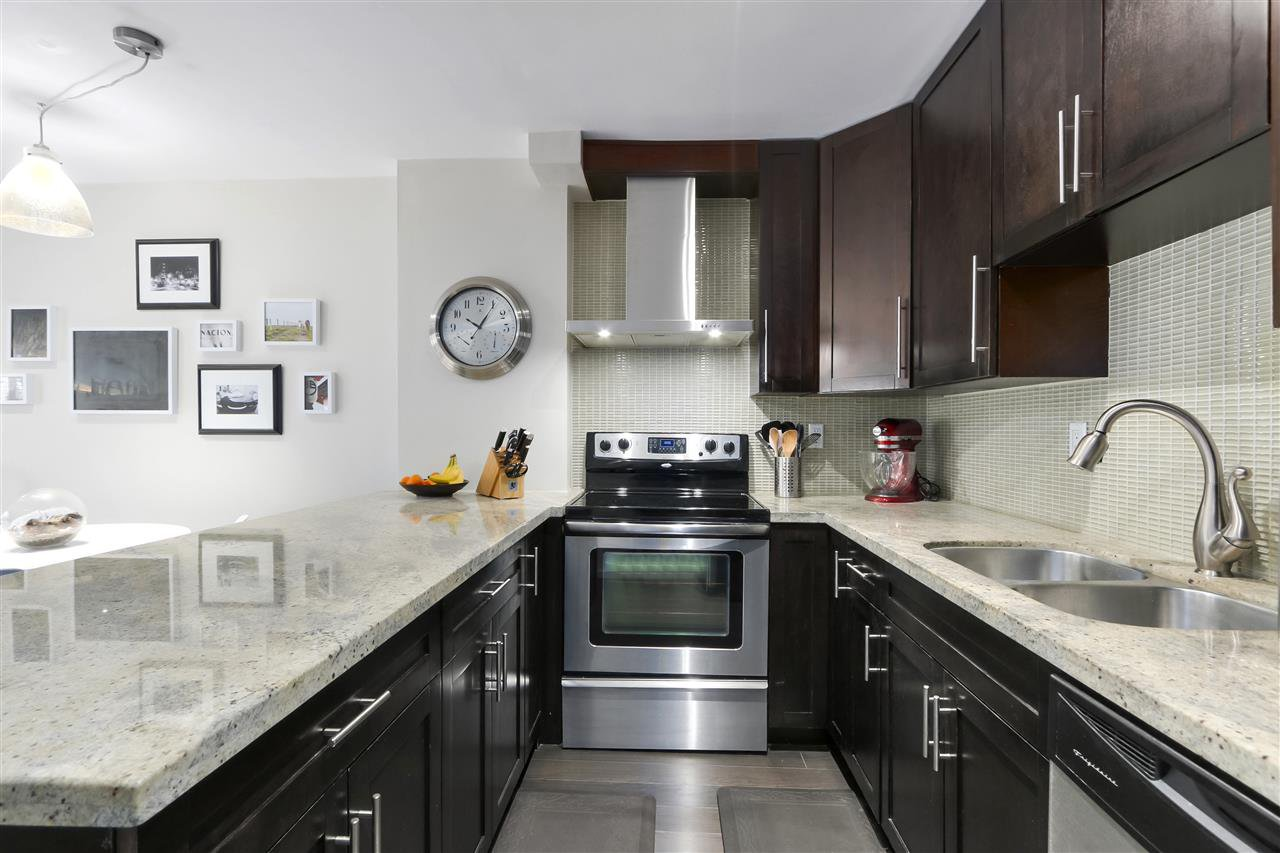 """Main Photo: 201 2215 DUNDAS Street in Vancouver: Hastings Condo for sale in """"HARBOUR REACH"""" (Vancouver East)  : MLS®# R2428776"""