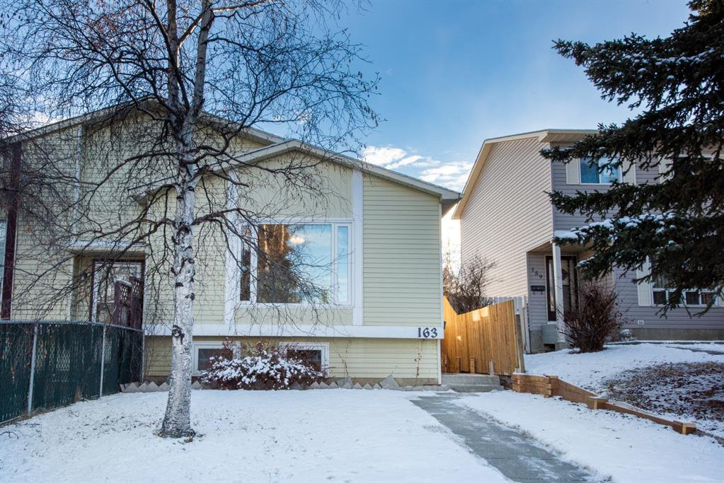 Main Photo: 163 Sandarac Way NW in Calgary: Sandstone Valley Semi Detached for sale : MLS®# A1054671