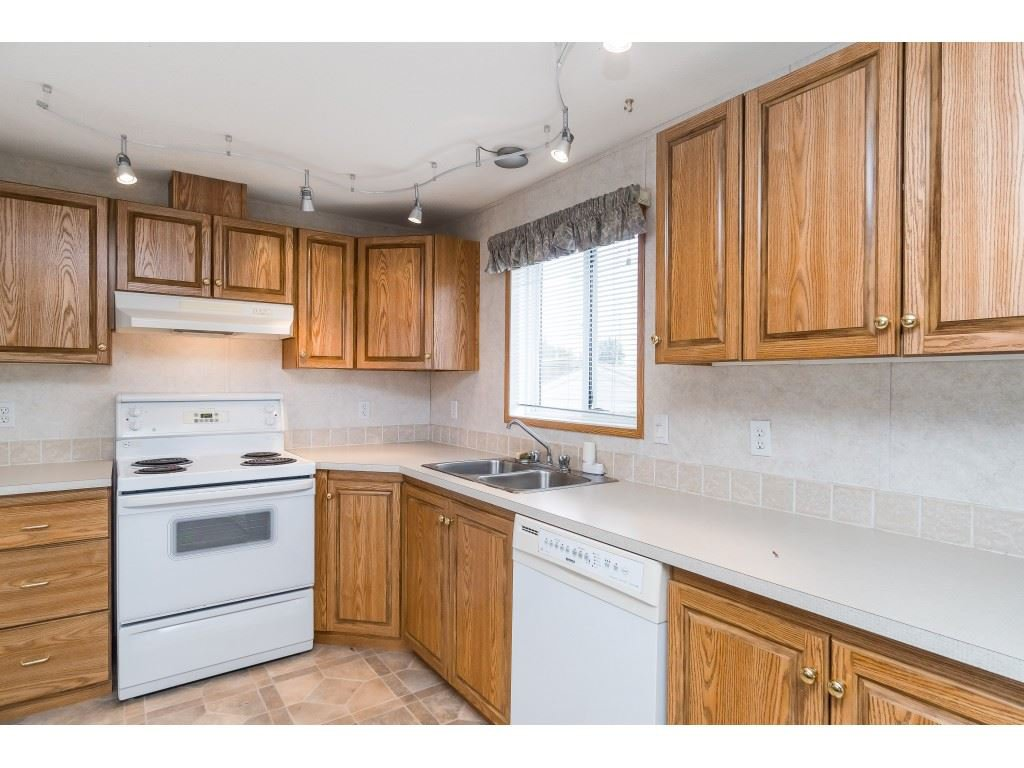 "Photo 5: Photos: 4 26892 FRASER Highway in Langley: Aldergrove Langley Manufactured Home for sale in ""Aldergrove Mobile Home Park"" : MLS®# R2409464"