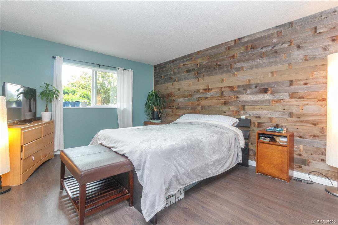 Large Master bedroom with real cedar feature wall and west facing window