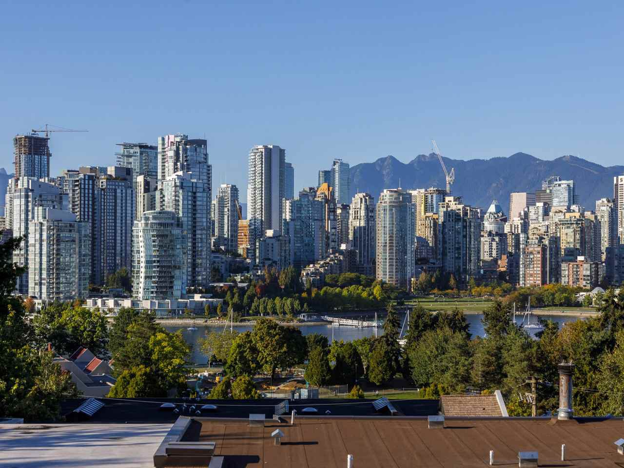 Amazing views of False Creek, Downtown Vancouver and the North Shore Mountains from your living room and your private office
