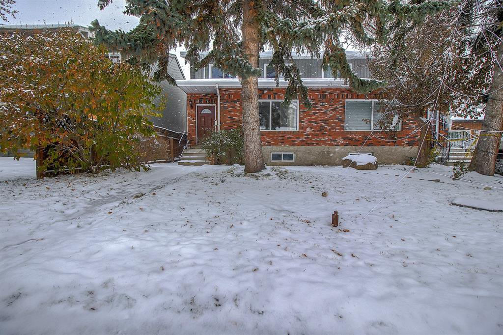 Main Photo: 834 68 Avenue SW in Calgary: Kingsland Semi Detached for sale : MLS®# A1059383