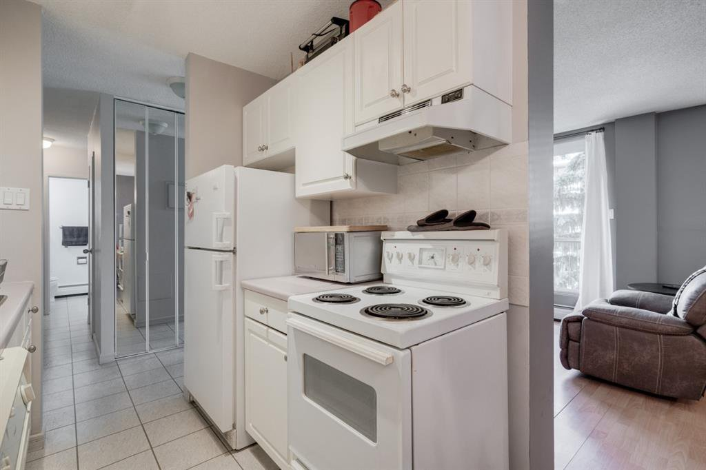 Main Photo: 401 1111 15 Avenue SW in Calgary: Beltline Apartment for sale : MLS®# A1010197