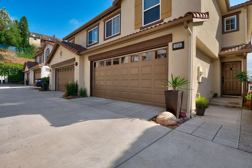 Main Photo: MISSION HILLS Condo for sale : 3 bedrooms : 3156 Harbor Ridge Ln in San Diego