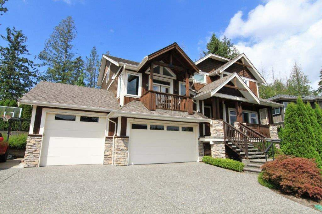 3 car garage, huge driveway with space on the side for RV parking or sports court