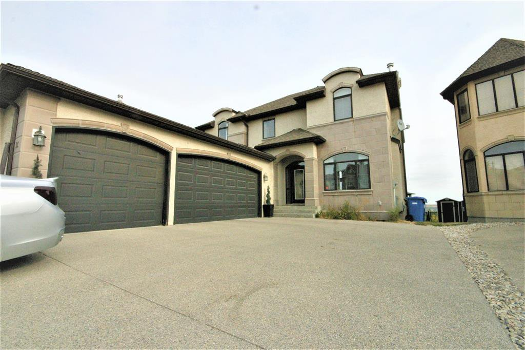 Main Photo: 36 Coulee Park SW in Calgary: Cougar Ridge Detached for sale : MLS®# A1036278