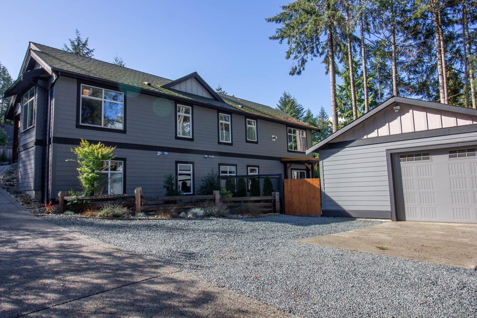 Main Photo: 2410 W Island Hwy in : PQ Qualicum Beach House for sale (Parksville/Qualicum)  : MLS®# 857150