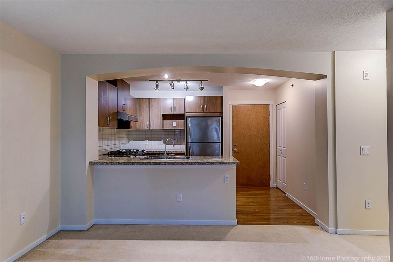 """Main Photo: 408 3082 DAYANEE SPRINGS Boulevard in Coquitlam: Westwood Plateau Condo for sale in """"THE LANTERNS"""" : MLS®# R2528071"""