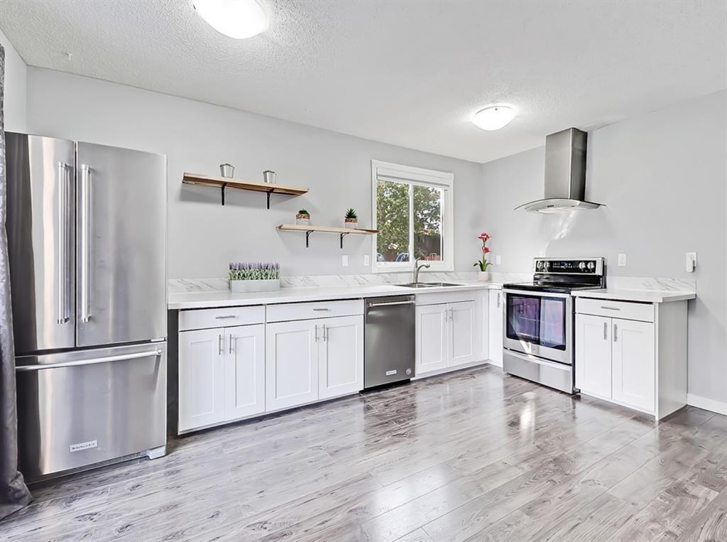 Main Photo: 235 ABOYNE Place NE in Calgary: Abbeydale Semi Detached for sale : MLS®# A1015805