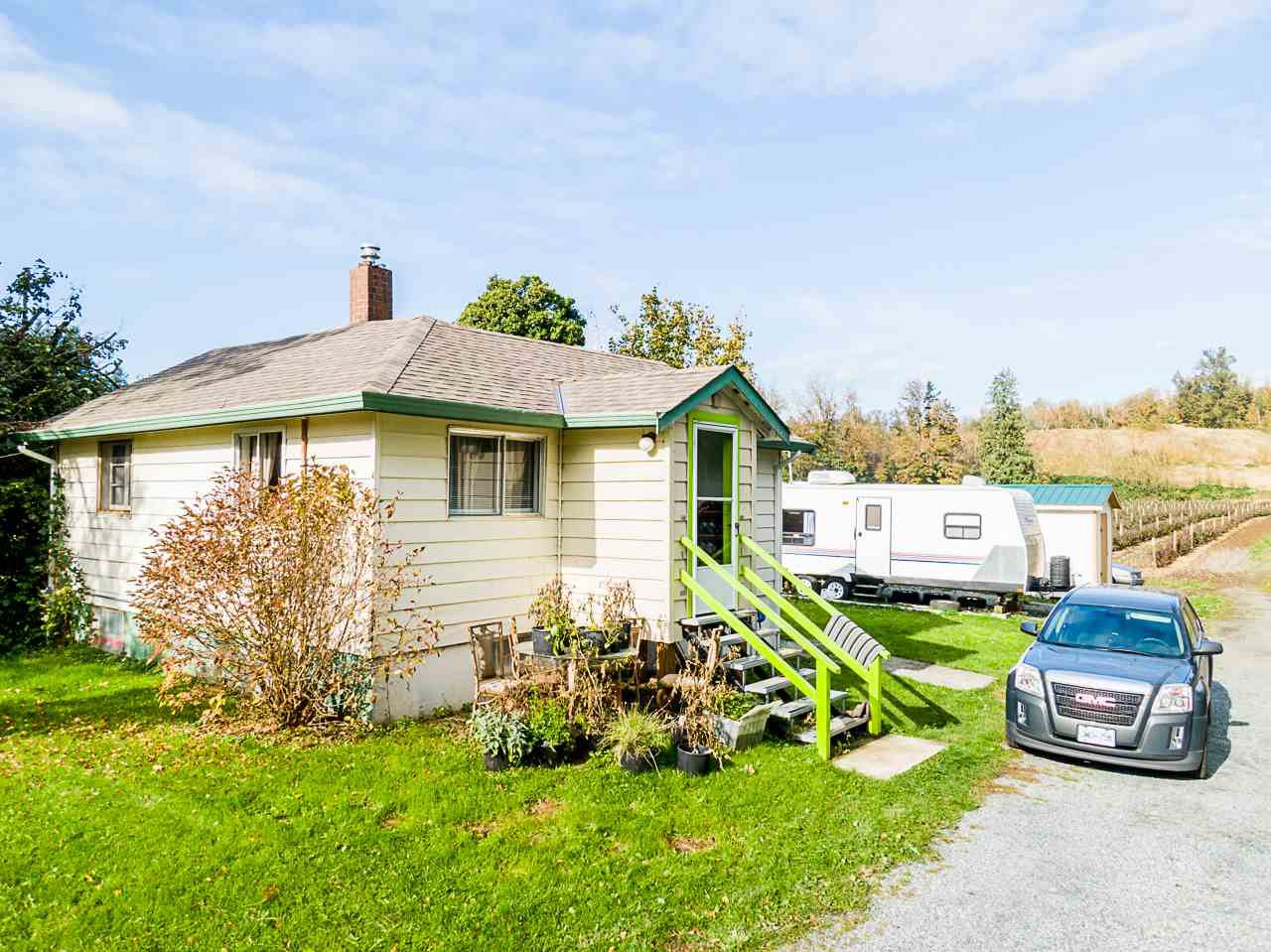 Main Photo: 34141 FARMER Road in Abbotsford: Poplar House for sale : MLS®# R2511876