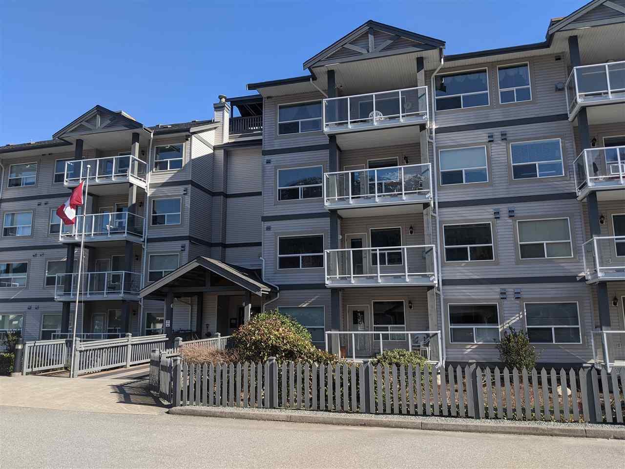 """Main Photo: 207 1203 PEMBERTON Avenue in Squamish: Downtown SQ Condo for sale in """"Eagle Grove 55+"""" : MLS®# R2518421"""