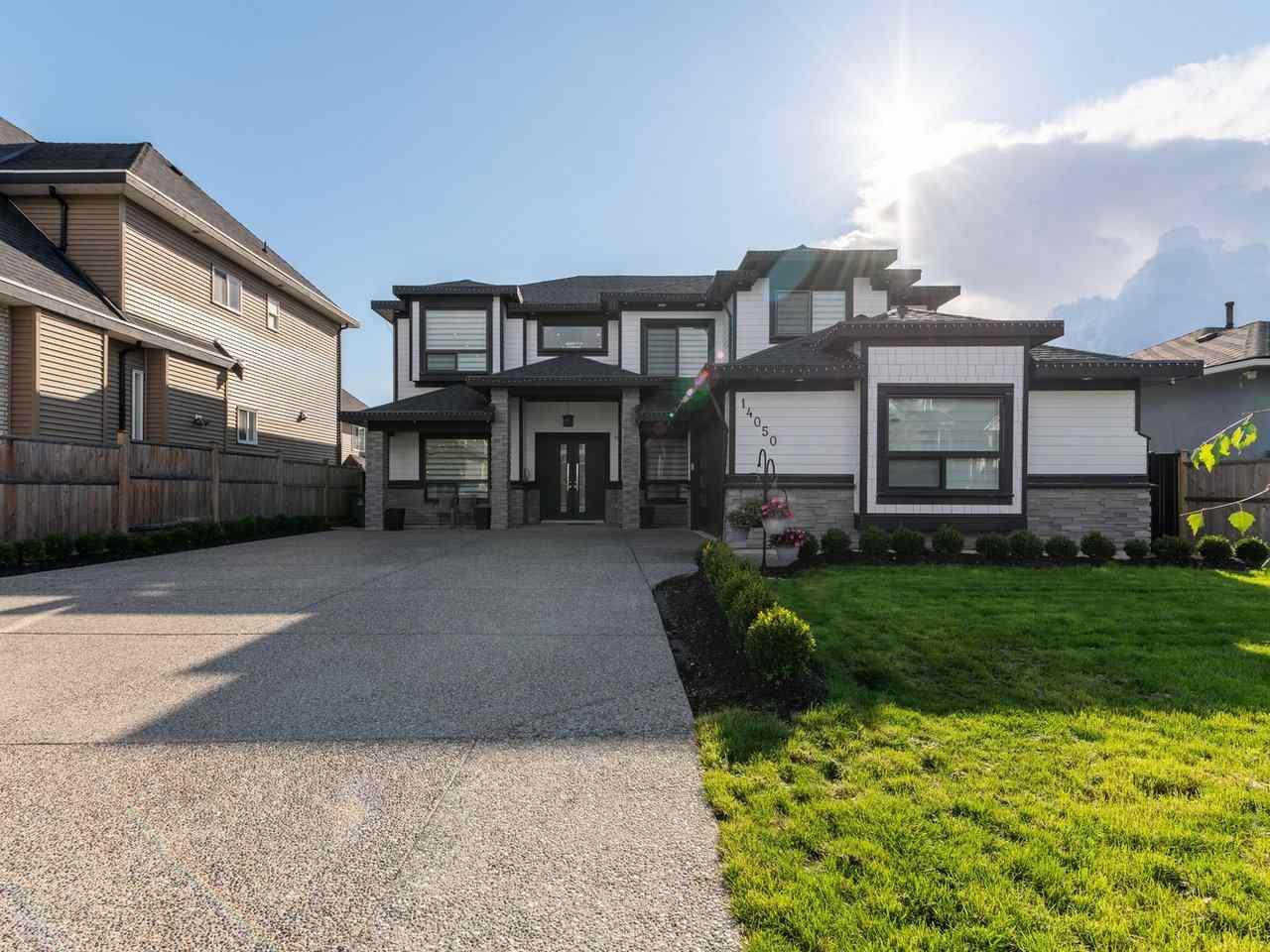 "Main Photo: 14050 91A Avenue in Surrey: Bear Creek Green Timbers House for sale in ""Bear Creek Green Timber"" : MLS®# R2511466"