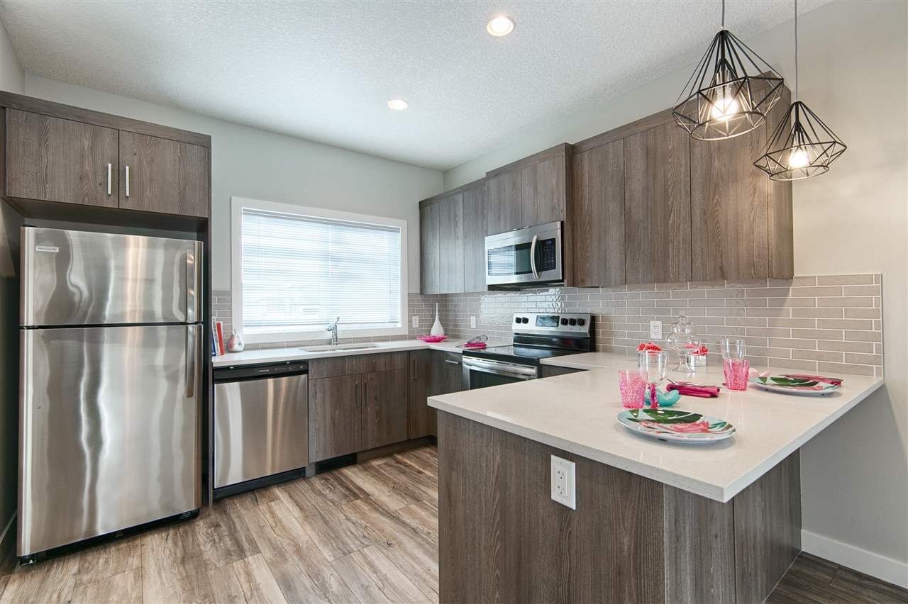 Main Photo: 233 Griesbach Road in Edmonton: Zone 27 House Half Duplex for sale : MLS®# E4218145