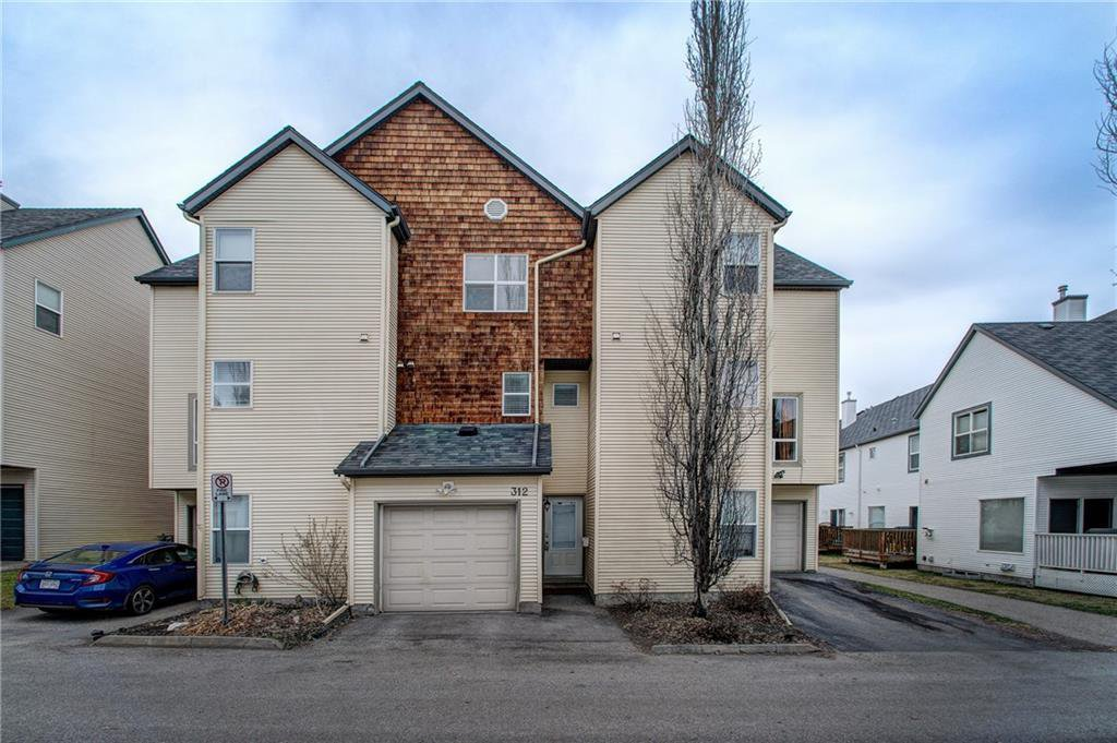 Main Photo: 312 BRIDLEWOOD Lane SW in Calgary: Bridlewood Row/Townhouse for sale : MLS®# A1046866