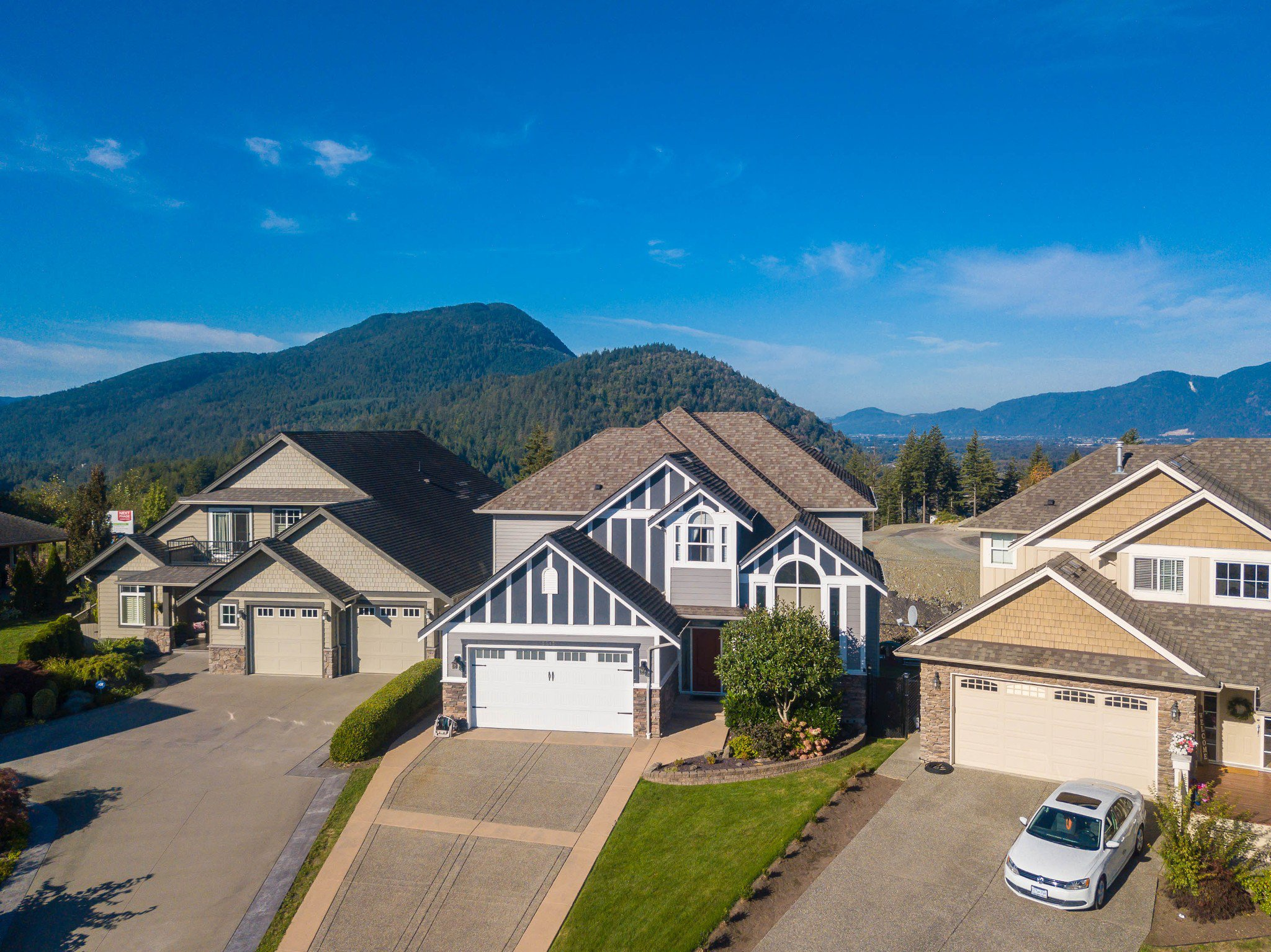 Welcome to 5213 Demontigny Court! This beautiful home is located in Sherwood Estates on the top of Promontory with Cultus Lake and Panoramic Western Sunset views. Relax on your back porch or in the yard with the kids and feel at home!