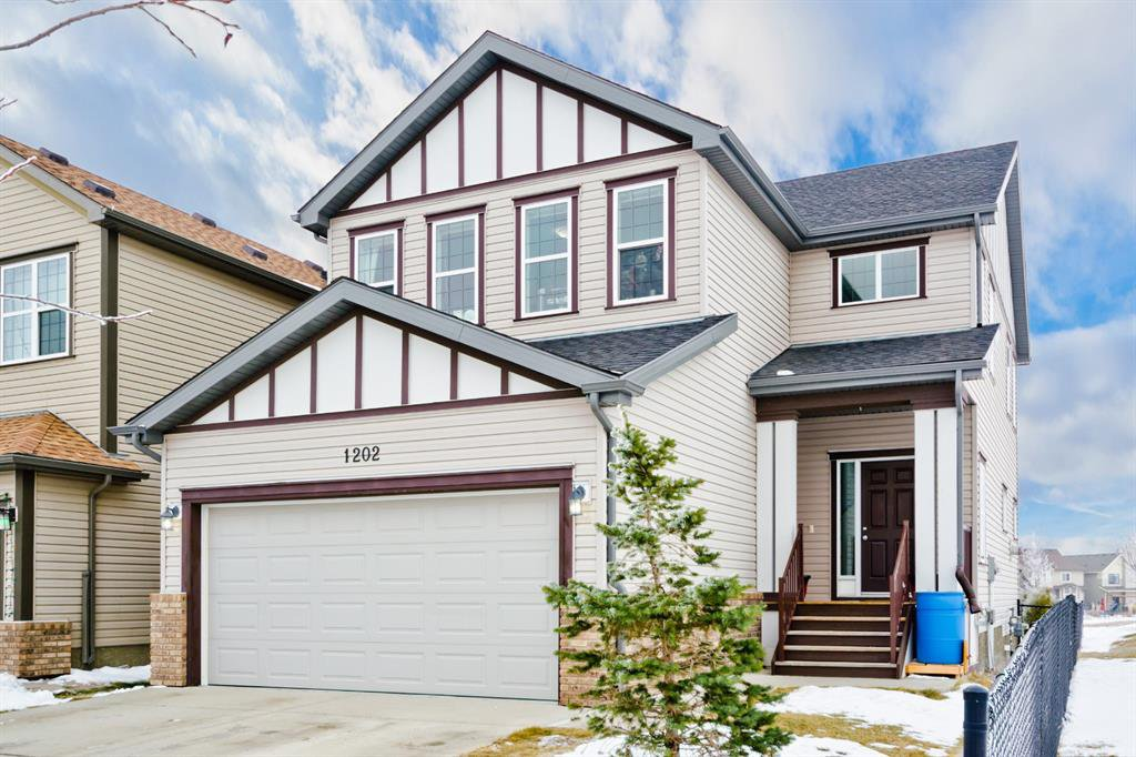 Main Photo: 1202 Reunion Road NW: Airdrie Detached for sale : MLS®# A1050160