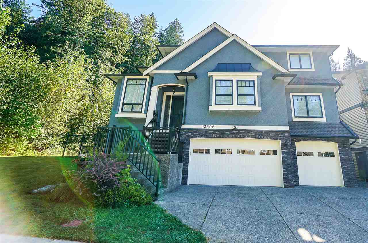 This beautiful home is located at the end of a quiet street close to walking trails and Maple Ridge Park! Did you notice the TRIPLE GARAGE? WHAT A BEAUTIFUL HOME, ONE OF A KIND! Lots of room for all your family including space for the in-laws.
