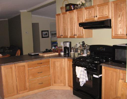 "Photo 4: Photos: 11 ROCKY MOUNTAIN Road in Fort_Nelson: Fort Nelson - Rural Manufactured Home for sale in ""SATENEH ESTATES"" (Fort Nelson (Zone 64))  : MLS®# N179978"