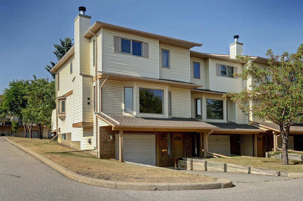 Main Photo: 100 PATINA Park SW in Calgary: Patterson Row/Townhouse for sale : MLS®# A1031053