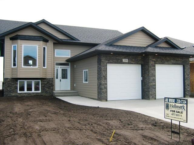 Main Photo: 208 NICKLAUS Drive in WARMAN: Saskatoon NW (Other) Single Family Dwelling for sale (Saskatoon NW)  : MLS®# 307823