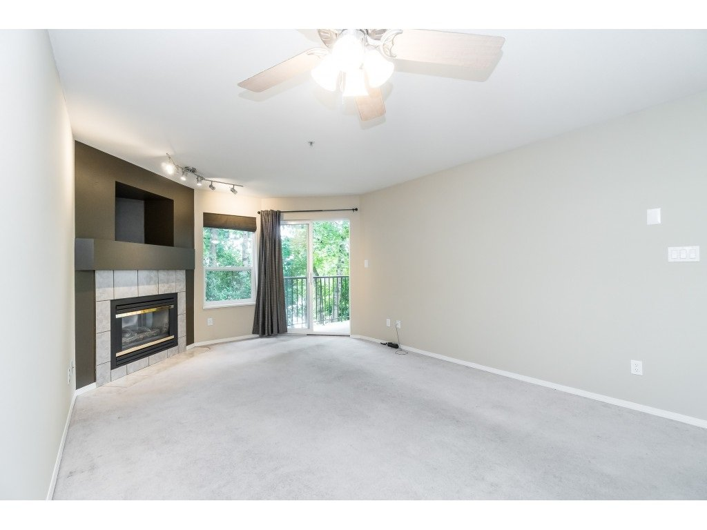 "Photo 10: Photos: 208 33480 GEORGE FERGUSON Way in Abbotsford: Central Abbotsford Condo for sale in ""CARMONDY RIDGE"" : MLS®# R2392370"