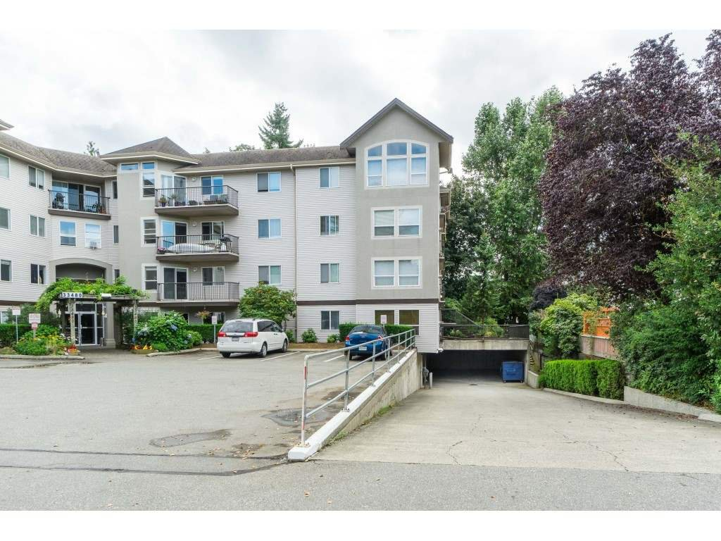 "Photo 2: Photos: 208 33480 GEORGE FERGUSON Way in Abbotsford: Central Abbotsford Condo for sale in ""CARMONDY RIDGE"" : MLS®# R2392370"